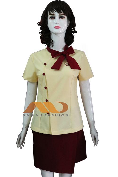 Đồng phục nhân viên đầm vàng thắt nơ